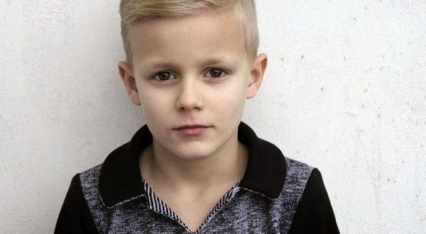 Business class little boy hair cutting